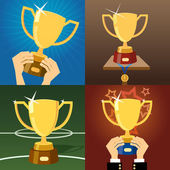 Set of four gold trophies or cups — Stock Vector
