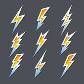 Set of zigzag lightning bolts or electricity icons — Stock Vector