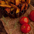 Stock Photo: Fried potatoes with tomatoes