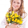 Stock Photo: Girl with bouquet of tulips