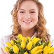 Smiling girl with a bouquet — Stock Photo