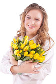 The girl with a bouquet of tulips — Stock Photo