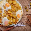 Stock Photo: Fried potatoes with egg