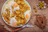 Fried potatoes with egg — Stock Photo