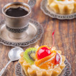 Stock Photo: Sweet cakes with cup of coffee
