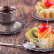Stock Photo: Sweet cakes on wooden table
