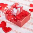 Stock Photo: Two gift boxes surrounded by soft hearts