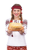 Girl in traditional costume with crepes — Stock Photo