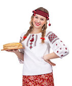 Girl with crepes in traditional clothes — Stock Photo