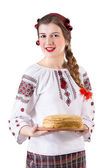 Girl with crepes in folk costume — Stock Photo