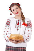 Russian girl with crepes in folk costume — Stock Photo