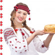 Stock Photo: Girl with crepes on national pattern