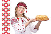 Girl with crepes on a national pattern — Stock Photo