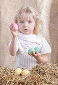 Little girl shows easter eggs — Stock Photo
