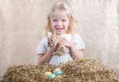 Smiling girl with Easter bunny — Stock Photo