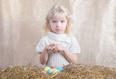 Easter little girl with colored eggs — Stock Photo