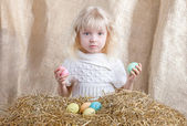Easter little girl holding colored eggs — Stock Photo