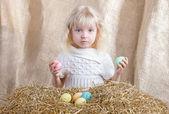 Easter little girl holding colored eggs — Stock Photo