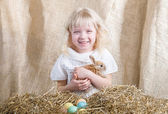 Laughing girl with Easter bunny — Stock Photo