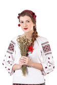 Russian girl in national costume with a bouquet — Stock Photo