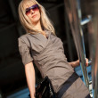 Beautiful woman standing on the shop — Stock Photo #12555170
