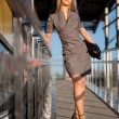 Beautiful woman standing on the shop — Stock Photo #12555173