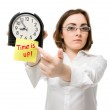 Girl points to clock (focus on clock) — Stock Photo #12555118