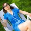 Womlying on sun lounger — Stock Photo #12555194
