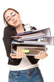 Beautiful businesswoman with a lot of folders calling by phone — Stock Photo
