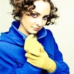 Постер, плакат: Curly haired woman in coat