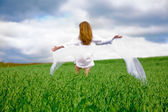 Woman on oat field — Stock Photo