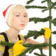 Womin yellow gloves with fir — Stockfoto #13174847