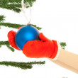 图库照片: Woman's hands dressing christmas tree