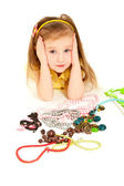 Little girl with a lot of jewel lying on the floor isolated — Stock Photo