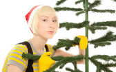 Woman in yellow gloves with fir — Stock Photo