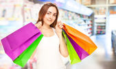 Picture of a beautiful woman with shopping bags — Stock Photo