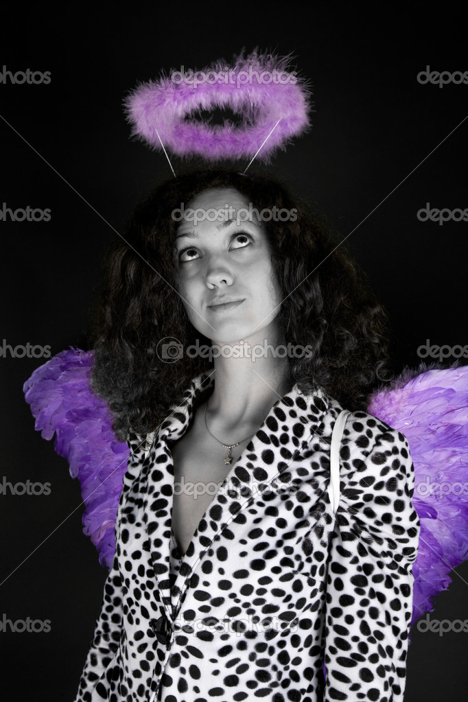 Beautiful woman in halloween costume on the black background  Stock Photo #13175019