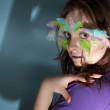 Girl with colorful feather on her face — Stock Photo