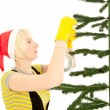 Womin yellow gloves with fir — Stockfoto #13544659