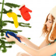 Woman dressing christmas tree — Stock Photo