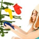 Woman dressing christmas tree — Stock Photo #13544768