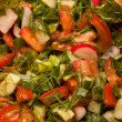 Salad consists of tomatoes, parsley, onion and cucumber - Stock Photo