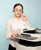 Businesswoman with copier — Stock Photo
