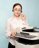 Businesswoman with copier — Stock Photo