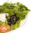 Stock Photo: Plate of lettuce, feta, black olives and tomatoes
