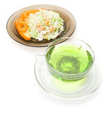 A cup of tea and a plate of salat — Stock Photo
