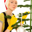 Womin yellow gloves with fir — Stockfoto #14379449