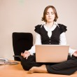 Young woman sitting in lotus pose — Stock Photo