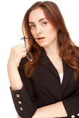 Beautiful businesswoman in black jacket looking to the camera — Foto Stock