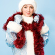 Girl in Snow Maiden costume with red tinsel - Stock Photo